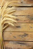 Sheaf of Wheat over Wooden table. Harvest concept Stock Photo