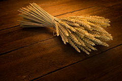 Sheaf of wheat. On rustic table Royalty Free Stock Image