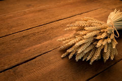 Sheaf of wheat. On rustic table Royalty Free Stock Images