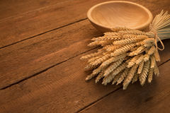 Sheaf of wheat. On rustic table Stock Photos