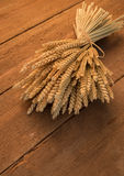 Sheaf of wheat. On rustic table Stock Image