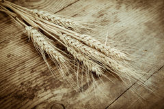 Sheaf of wheat on wooden background Royalty Free Stock Images