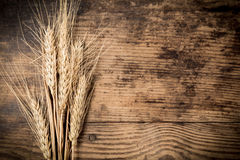 Sheaf of wheat on wooden background Royalty Free Stock Photo
