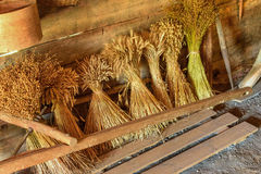 Sheaps of wheat and herbs in the shed of a village Royalty Free Stock Photos