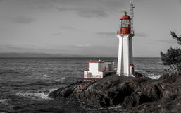 Shearingham Lighthouse black and white. Black and white with red contrasting features of Shearingham Lighthouse on Vancouver Island, British Columbia Canada as Stock Images
