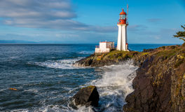 Shearingham Lighthouse. On Vancouver Island, British Columbia Canada as waves from the Pacific Ocean crash on its rocky shore Stock Photo