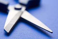 Shears. Open shears on blue background. Small DOF Stock Photo
