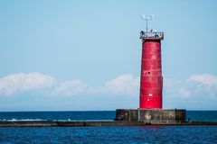 Sheboygan Breakwater Lighthouse. Sheboygan lighthouse displaying it& x27;s trademark red color, and NOAA weather equipment royalty free stock photo