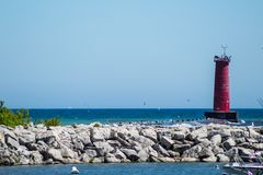Sheboygan Lighthouse. Long shot of the Sheboygan lighthouse from the southwest with birds flying about Royalty Free Stock Photography