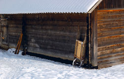 Shed. Working barrow on the corner of the barn in the mountain economy. Ukrainian Carpathians stock image
