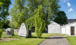 Shed  in a cimetery. Shed in a cimetery with trees on a bright blue sky Stock Photography