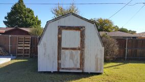 Shed on Grass Stock Image
