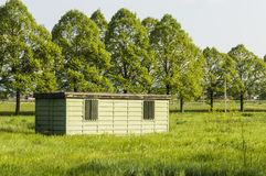 Shed in the grass Royalty Free Stock Image