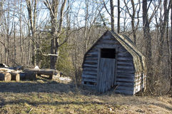 Shed and logs royalty free stock photo