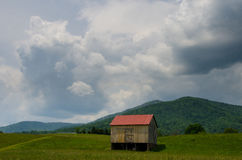 Shed on mountain side. Hill Stock Photo