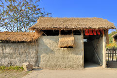 Shed by mud and grass, in china countryside Royalty Free Stock Photo