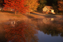 Shed near lake in autumn, CT Royalty Free Stock Images