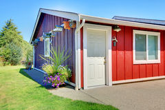 Shed in purple and red with bird houses. Stock Images
