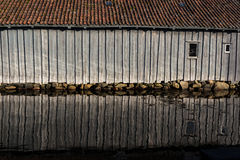 Shed reflection over water Stock Photos