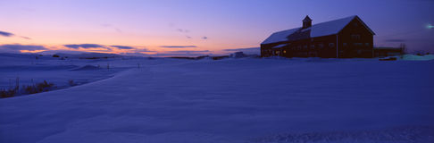 Shed in snow. In dwindling twilight, Vermont Royalty Free Stock Photo