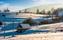 Shed on snow covered agricultural hillside. Lovely rural scenery in winter Royalty Free Stock Photos