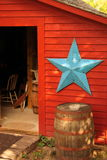 Shed with Star. Large blue star on small garage, or shed Royalty Free Stock Photography
