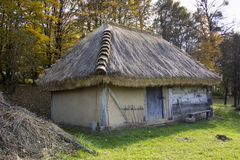 Shed with straw roof. Old wooden shed with a straw roof Royalty Free Stock Photo