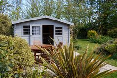 Shed with terrace and garden furniture Royalty Free Stock Photos