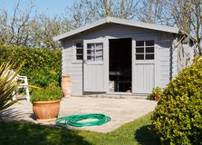 Shed with terrace. In a garden during spring Royalty Free Stock Images