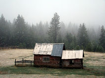 Shed in Winter. A shed in winter getting snowed on in a field Royalty Free Stock Photo