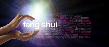 Shedding light on Feng Shui. Female hands cupped around the words FENG SHUI surrounded by a relevant word cloud with a spiraling bright light vortex behind royalty free stock photography