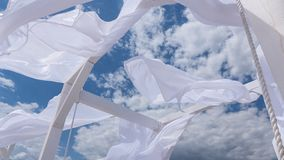 Sheds awning with fabric curtains on the seashore breeze in the wind. Sheds awning with fabric white curtains on the seashore breeze in the wind royalty free stock images
