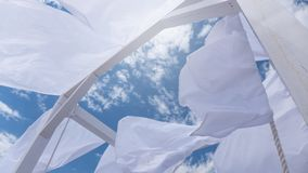 Sheds awning with fabric white curtains on the seashore breeze. In the wind royalty free stock photography