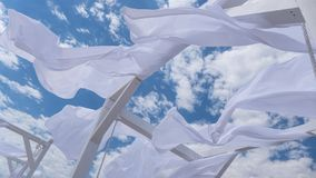 Sheds awning with fabric white curtains on the seashore in the wind. Sheds awning with fabric white curtains on the seashore breeze in the wind royalty free stock photos