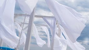 Sheds awning with fabric white curtains on the seashore in the wind. Sheds awning with fabric white curtains on the seashore breeze in the wind royalty free stock photography