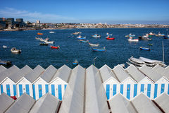 Sheds and Boats Moored at Bay in Cascais Stock Image