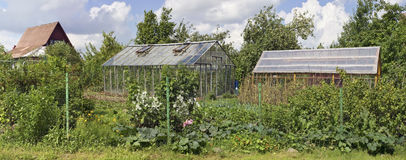 Sheds, greenhouses, fences and kitchen gardens Stock Photo