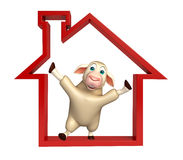 Sheep cartoon character with home sign Royalty Free Stock Photo