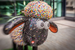 Sheep charity moneybox. One of Aardman's Shaun the Sheep characters on display around the centre of Bristol in August 2015 set up to collect money for children Royalty Free Stock Images