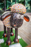 Sheep charity moneybox. One of Aardman's Shaun the Sheep characters on display around the centre of Bristol in August 2015 set up to collect money for children Stock Photo