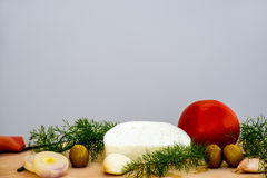 Sheep cheese with olives, tomatoes Stock Photos