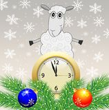 Sheep, clock and green branches with toys Stock Photography