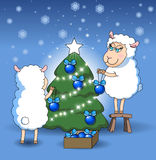 Sheep decorate a Christmas tree Royalty Free Stock Photography