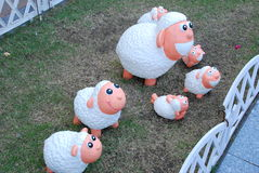Sheep dolls in the garden Royalty Free Stock Image