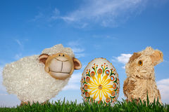 Sheep, Easter eggs and straw rabbit Royalty Free Stock Image