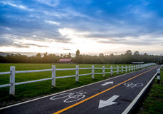 Sheep farm and bike road Stock Photos
