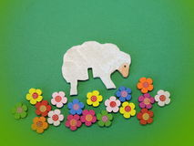 Sheep and flowers. Wood carving Royalty Free Stock Images