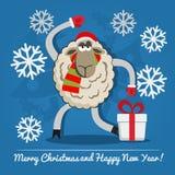Sheep with gift box on Christmas Eve. Stock Photos