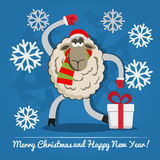 Sheep with gift box on Christmas Eve. Stock Photos
