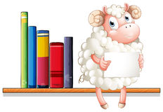 A sheep holding an empty signage sitting above the wooden shelf Royalty Free Stock Photos